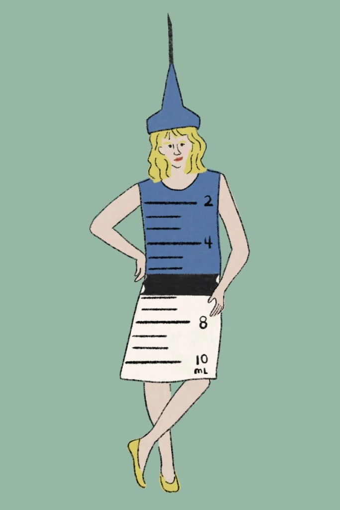 halloween costume of a vaccine illustration: a blonde woman wears a blue and white shift dress with numbers drawn on to look like a syringe. She's wearing a tall sharp hat that looks like a needle. The background is green.
